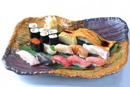 万年斑驳树影下的寿司店