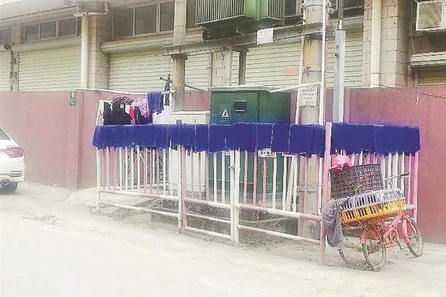 """""""变压器""""围栏上竟晾衣物 电力设备附近晾晒衣服安全"""