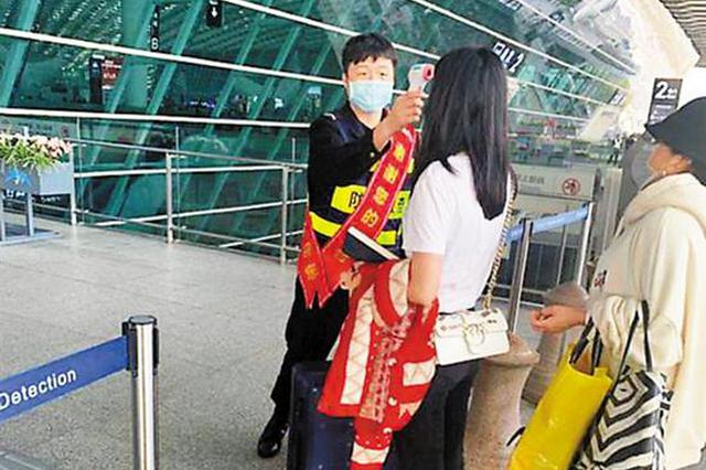 进入机场航站楼需测体温 对武汉进港航班采取定点保障模式