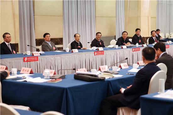 图为 周强参加十三届全国人大一次会议河南代表团审议。孙若丰 摄
