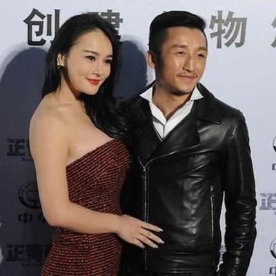 邹市明娇妻与黑人拳王霍利菲尔德合影,网友:美多了