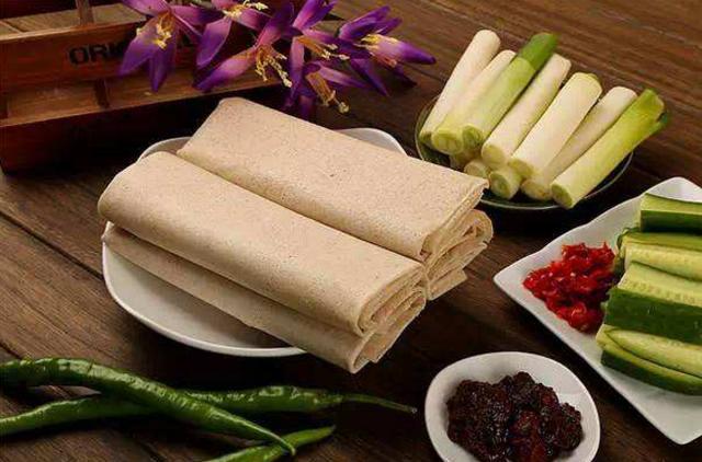 煎饼卷大葱可以代表山东美食吗?