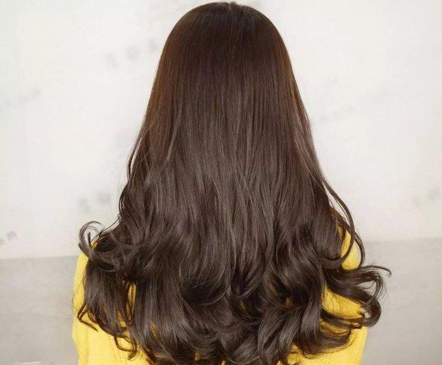 中长发打理成烫发会显得更加的浪漫和唯美 留着长头发的女生们,你知道图片