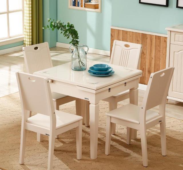 简约现代伸缩钢化玻璃餐桌椅组合 正方形餐桌简约现代伸缩钢化玻璃餐桌椅组合小户型饭桌定金100抵200桌面钢化玻璃材质,硬度高,易清洁,耐高温,使用安全。采用环保健康哑光钢琴烤漆,色泽亮丽,气味清新。加厚实木板材,环保耐用。可伸缩创意设计,联动双轨道,完美适配小户型。 北欧客厅电视柜茶几背景墙吊柜套装
