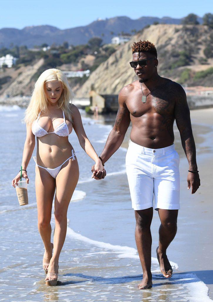 欧美白妇干黑人_欧美女星stodden和黑人男友海边度假,一黑一白对比明显