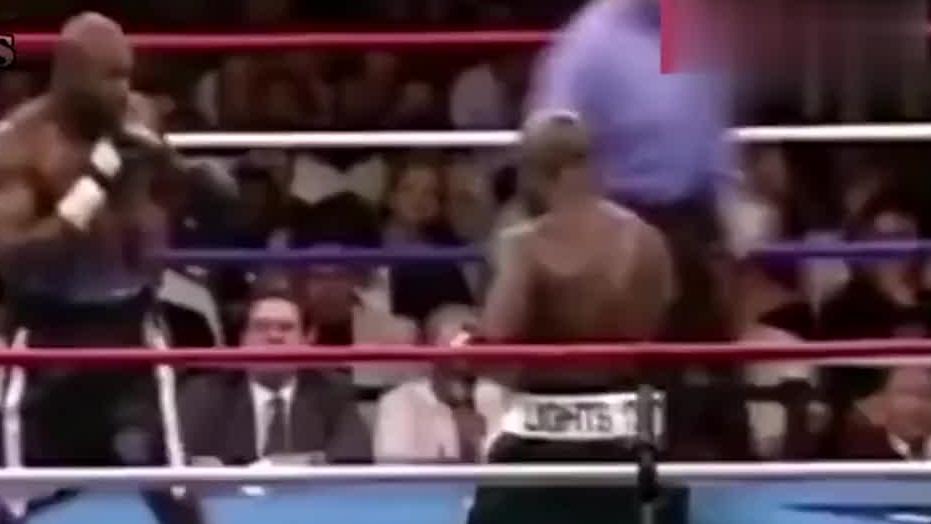 霍利菲尔德被连续重拳击打,教练无奈扔白毛巾认输