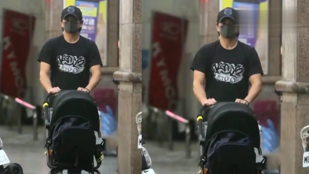 49岁吴奇隆现身带娃,亲自推婴儿车一起散步,与儿子对视充满爱意