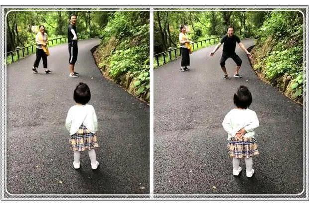 一家三口逛公园,爸爸妈妈手牵手很亲密,女儿吃醋撒娇要抱抱