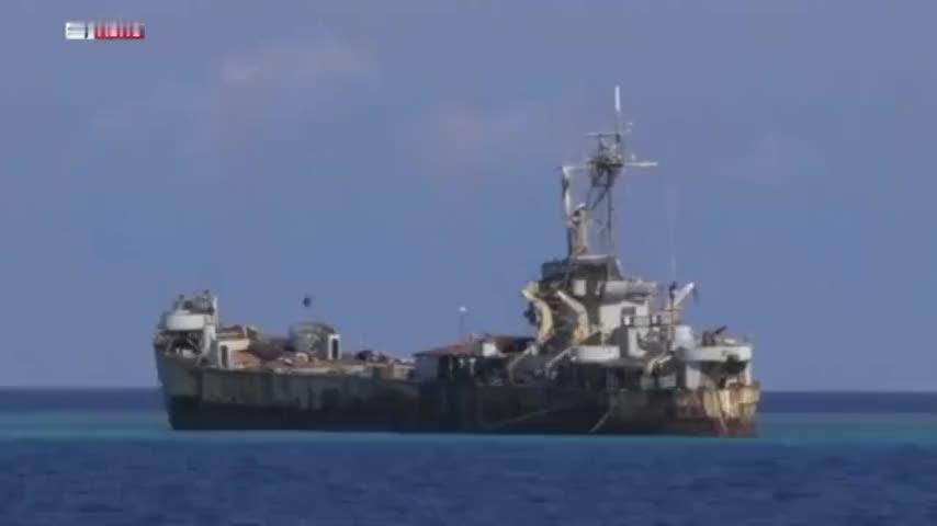 英国记者拍摄的在我南沙群岛仁爱礁礁盘上的菲律宾破军舰至