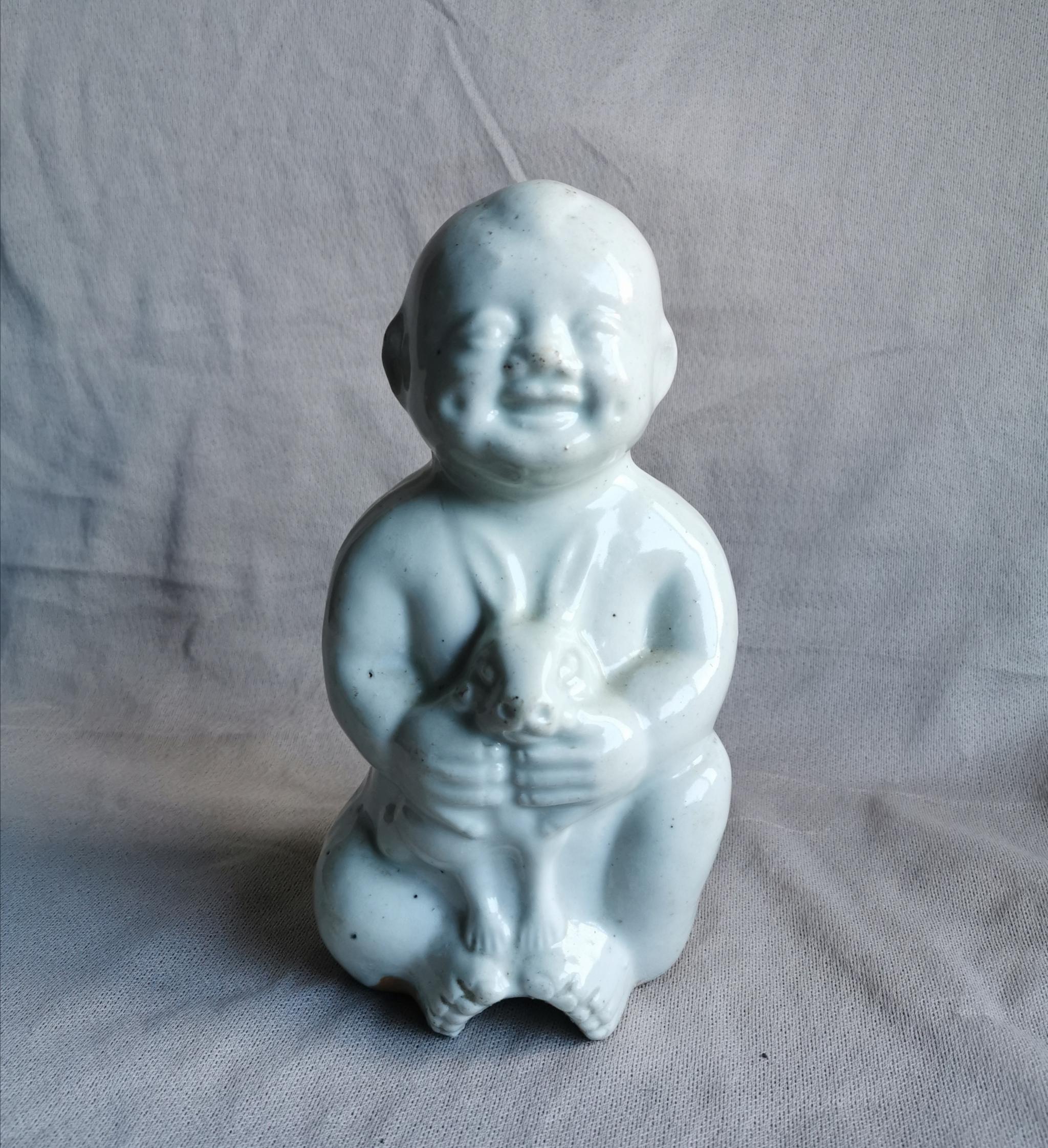 民国白瓷娃娃抱玉兔童子像寓意研究