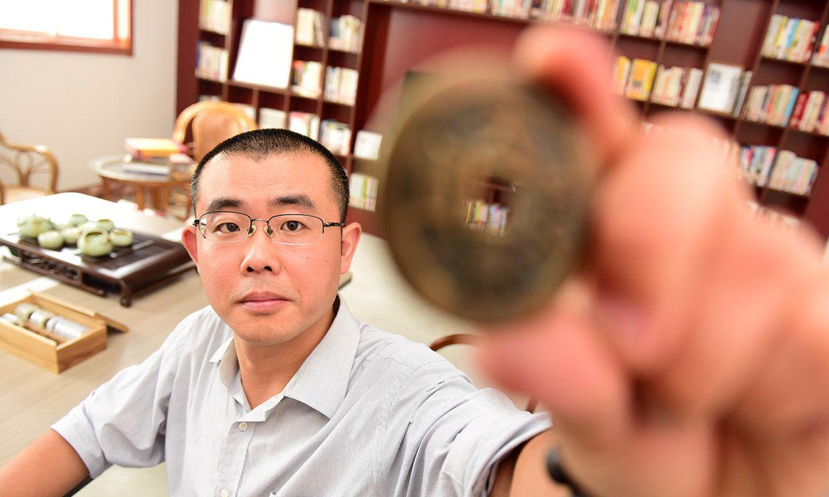 他用14年收藏万枚古钱币 自建古钱博物馆