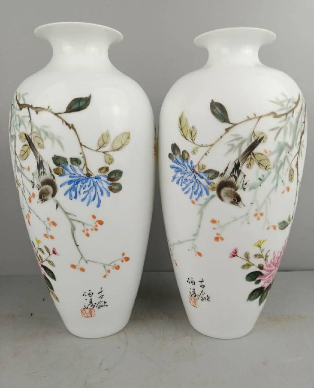 景德镇制精品文革老花瓶,这个不敢说真假,但是摆在家里很漂亮!