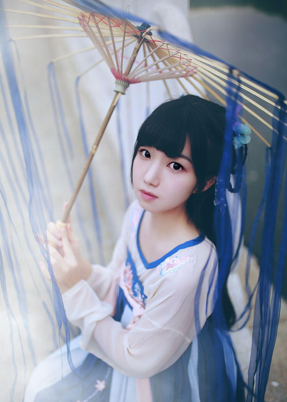 人像摄影:撑着古代伞的古装女子