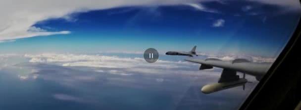 我是中国空军,正在国际空域飞行训练,请勿干扰我们行动!