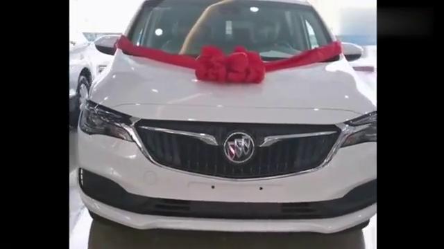 视频:新款别克GL6到店,看了白色外观和棕红色座椅,下决心买回家。