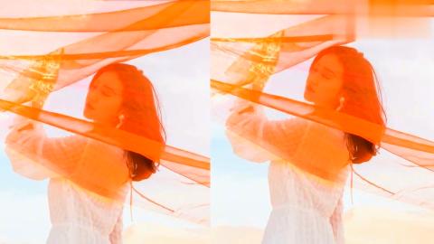 景甜敦煌沙漠舞动红纱,白裙点缀心形耳环风情万种