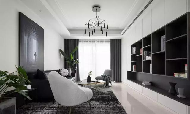 惠州石湾镇天誉湾三居室,这套现代风格演绎出简约轻奢气质