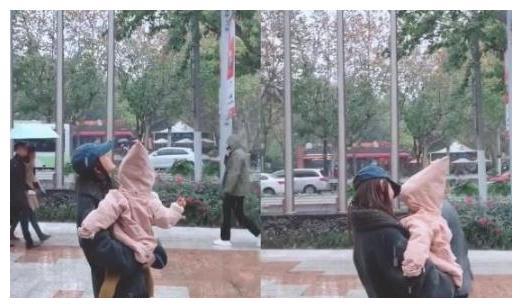 张子萱抱着女儿看初雪,二岁的安安好可爱,小腿胖乎乎像藕节
