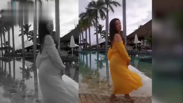 49岁张庭一袭黄色露肩裙赤脚海边翩翩起舞,身材好,少女感十足