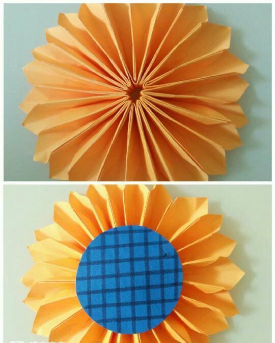 蓝色卡纸剪出一个圆形,在里面画上格子(如果是用棕色的话效果会更好)