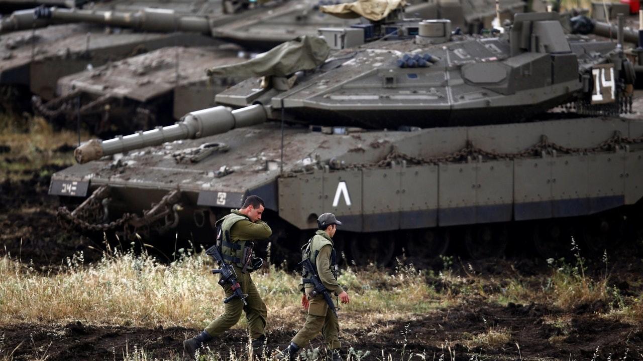 冲突_以色列国防军斥伊朗发射20枚导弹 24小时内两国屡次冲突