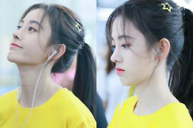 鞠婧祎机场终于把头发扎起来了,俏皮马尾加小黄人造型图片
