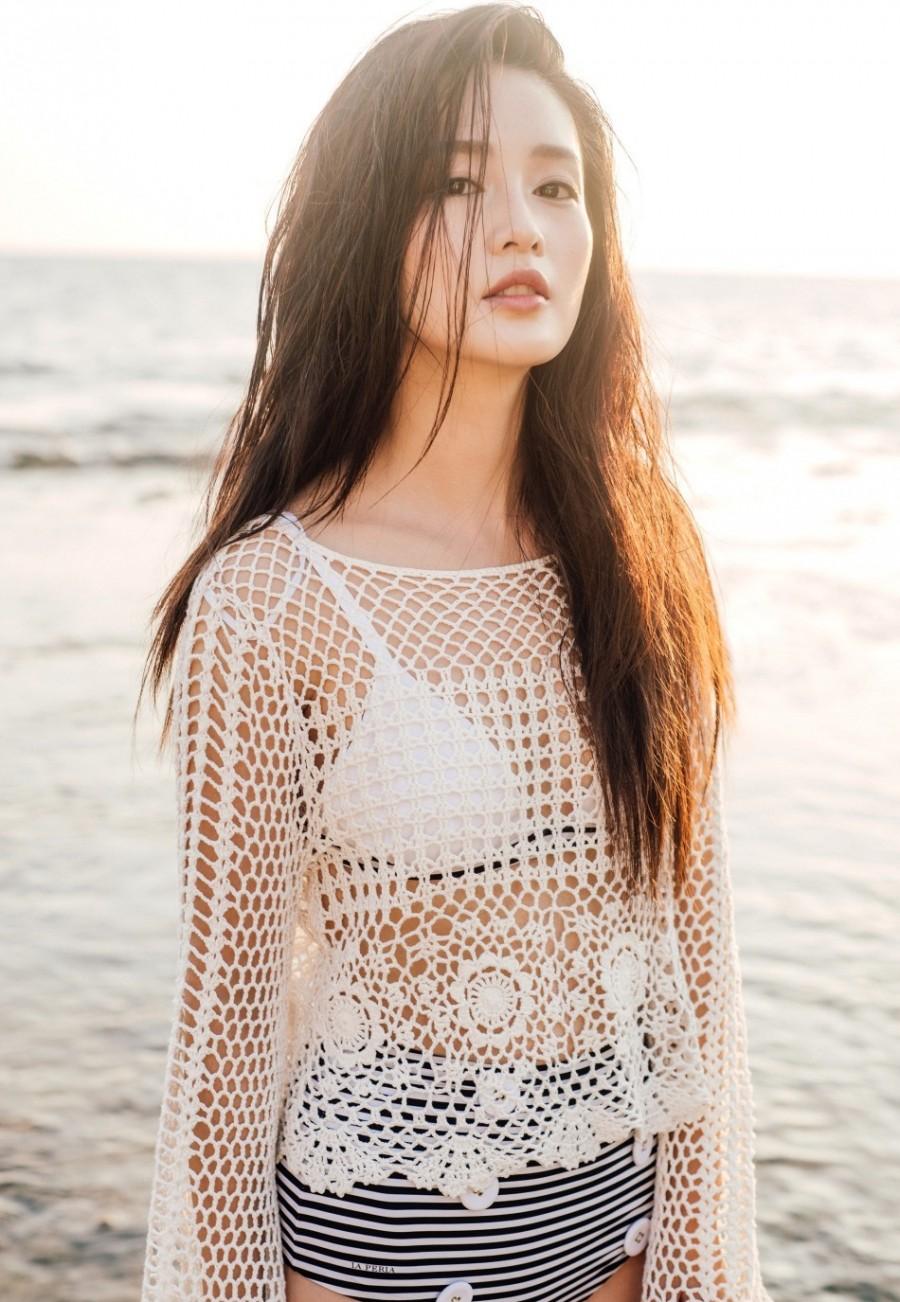 李沁海边写真小露性感镂空比基尼外搭身着罩性感拍v性感视频牛仔裤街图片