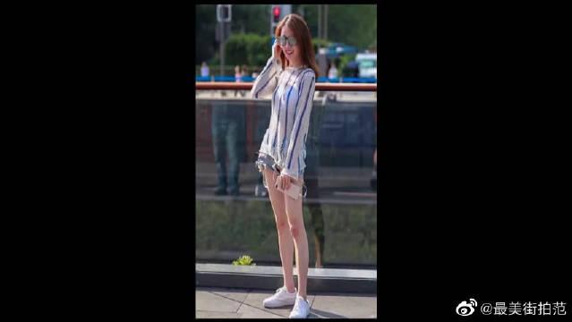 长发妹子衣袂飘飘,白皙长腿性感十足,戴着墨镜,又酷又美