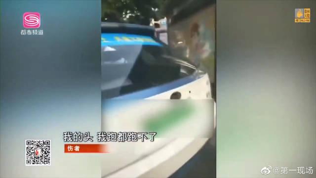 出租车疑逆行冲上公交站台,伤者:我想跑都跑不了