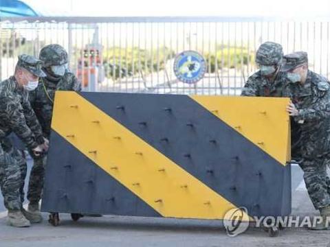 朝媒密集报道韩疫情急剧传播 10万人团体操照演