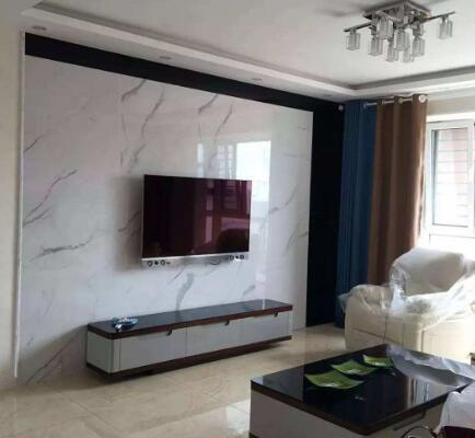 客厅电视墙别用大理石做了,如今流行使用石膏线,简约大气还省钱