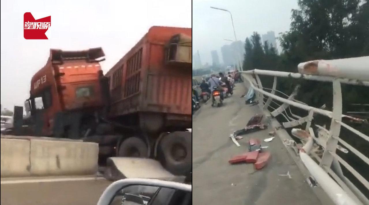 """大货车失控撞断防护栏再撞隔离栏,惨遭""""骨折"""":车头撞到车身中"""