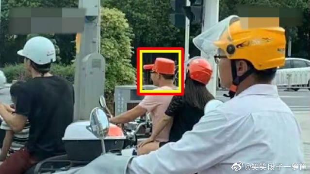骑电动车没有头盔怎么办,还好有个水瓢啊!
