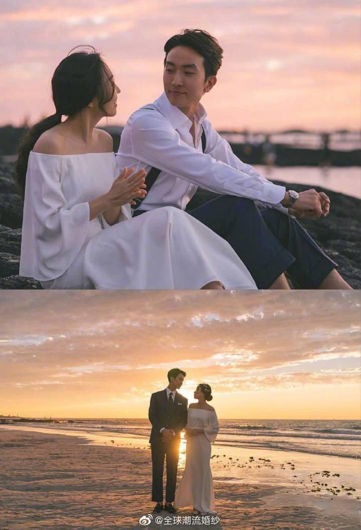 夕阳下 的婚纱照