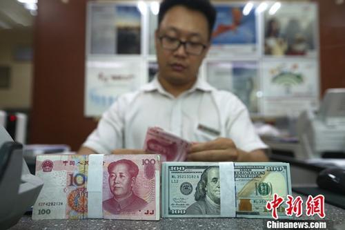 外汇管理局:6月银行结汇9795亿元 售汇11123亿元