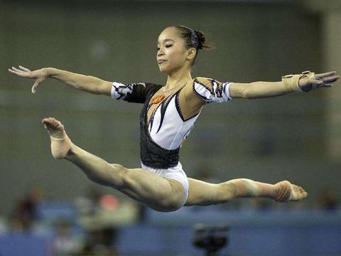 我国有名女子体操队员在未改名之前一金难得,她就是姚金男
