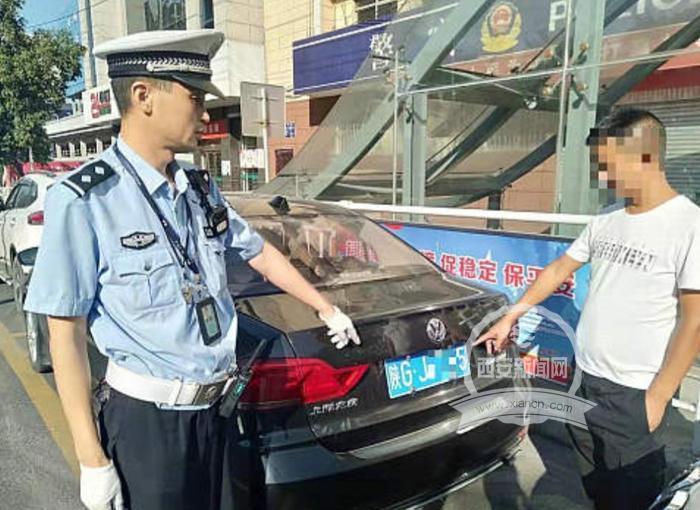 男子逃避电子警察抓拍用纸巾遮挡车牌 驾驶证被扣12分