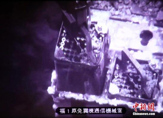 资料图:4月15日,日本东京电力公司启动了从福岛第一核电站3号机组反应堆旁的乏燃料池搬出燃料的作业。图片来源:东方IC 版权作品 请勿转载