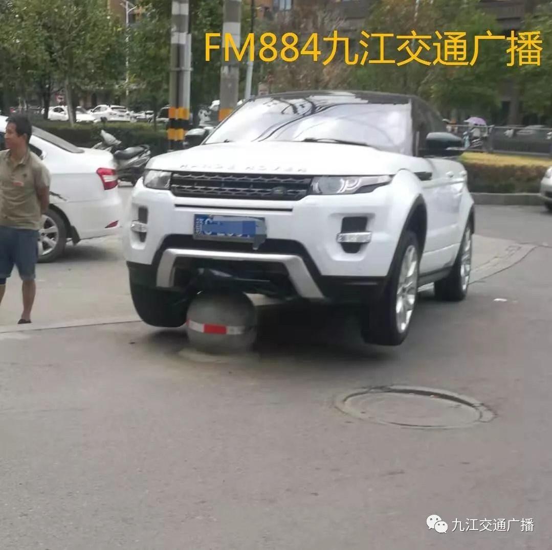 """开车冲上了石墩 九江这个司机""""骑虎难下""""(图)"""