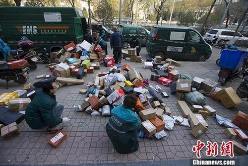 """中国邮政发力解决农产品进城""""最初一百米""""难题"""
