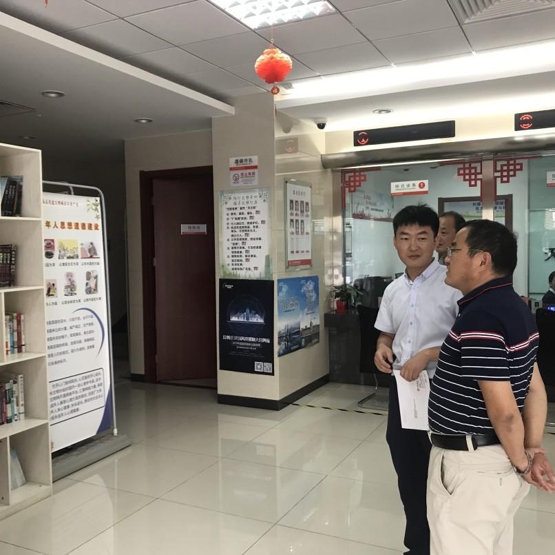 津南区图书馆对津南村镇银行辛庄支行 图书流动服务点进行核查