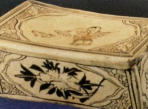 卧床男孩形定窑白瓷枕——枕的使用