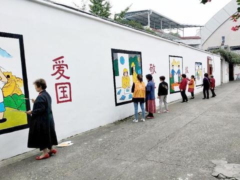 """""""社会主义""""绘上墙,社区文化建设在加强"""