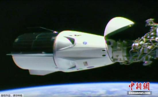 资料图:当地时间2019年3月3日,NASA在任务现场直播视频宣布,SpaceX载人龙飞船成功与国际空间站进行对接。