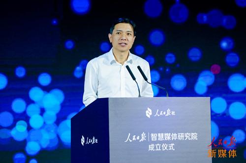 李彦宏打造首个AI编辑部 落地人民日报