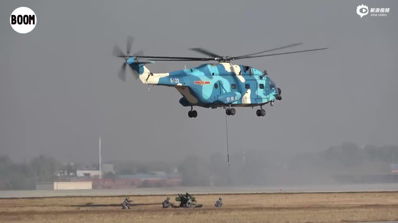 视频:空军开放日直-8空中悬停吊运高射机枪火力支援