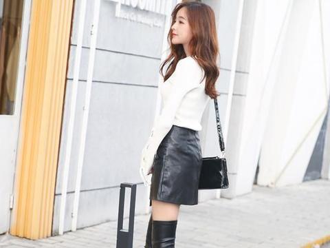 街拍:长筒靴的美女完美地修饰女性的腿型,尽显个性潮流范儿