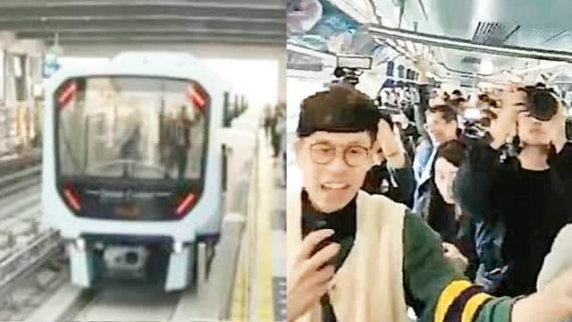澳门正式迈入轻轨时代!  市民在车厢内欣喜欢呼