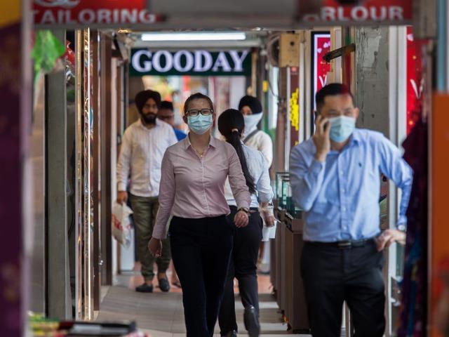 不戴口罩也不封城,新加坡为何受世卫组织表扬?日韩调查后沉默了
