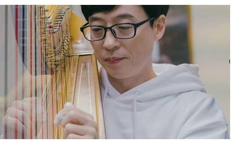 刘在石手贴胶布苦练竖琴 2千人前呈现完美演出